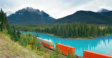 Freight train crossing Canadian landscape
