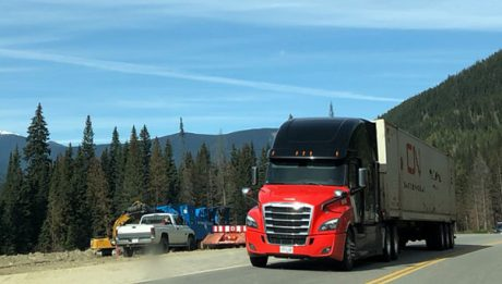 CN truck on a road in Alberta, example of intermodal freight